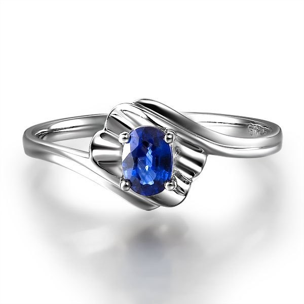 solitaire sapphire engagement ring on 18k white gold