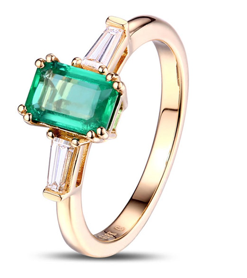 1 carat emerald and trilogy engagement ring in