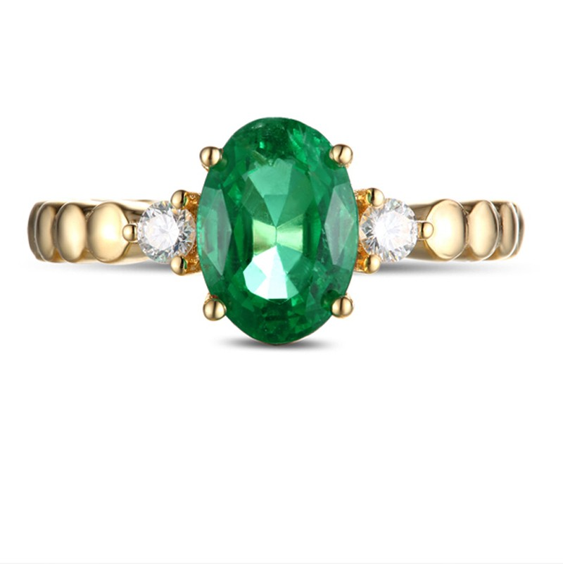 1 carat green emerald and trilogy engagement ring