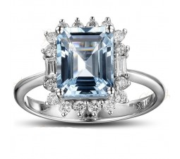 Beautiful 1.50 Carat blue topaz and diamond halo engagement ring in white gold
