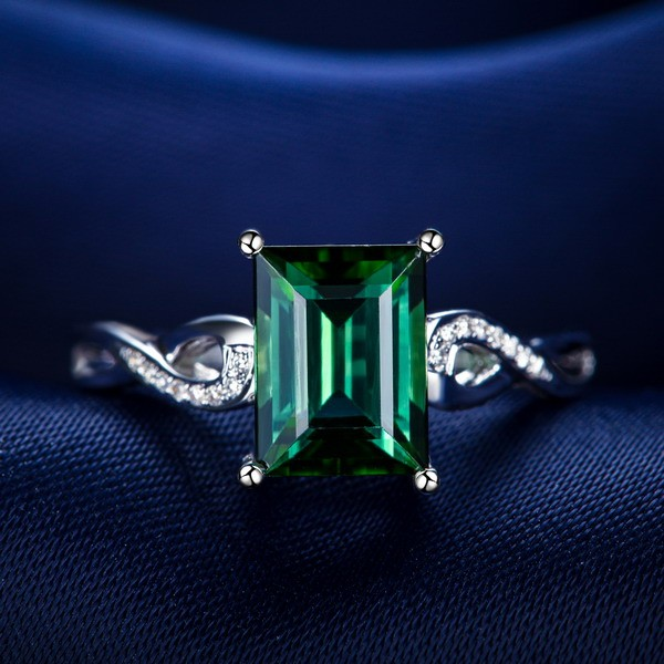 unique 150 carat emerald and diamond infinity engagement
