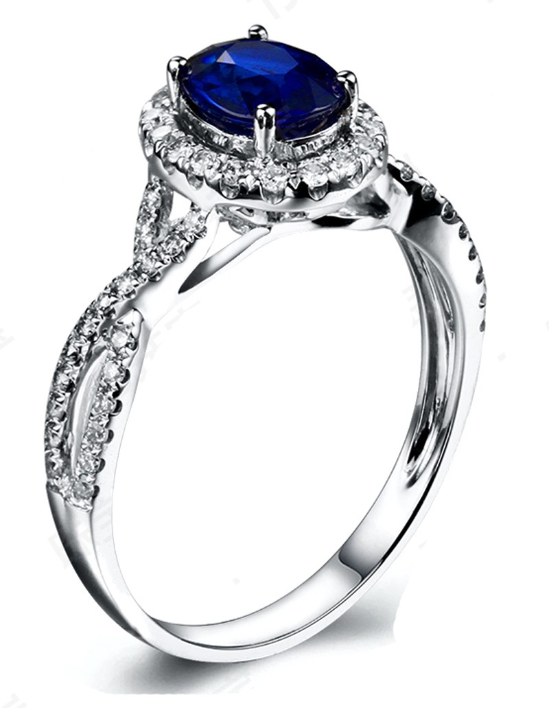 2 Carat oval cut Blue Sapphire and Diamond Halo Engagement Ring in White Gold