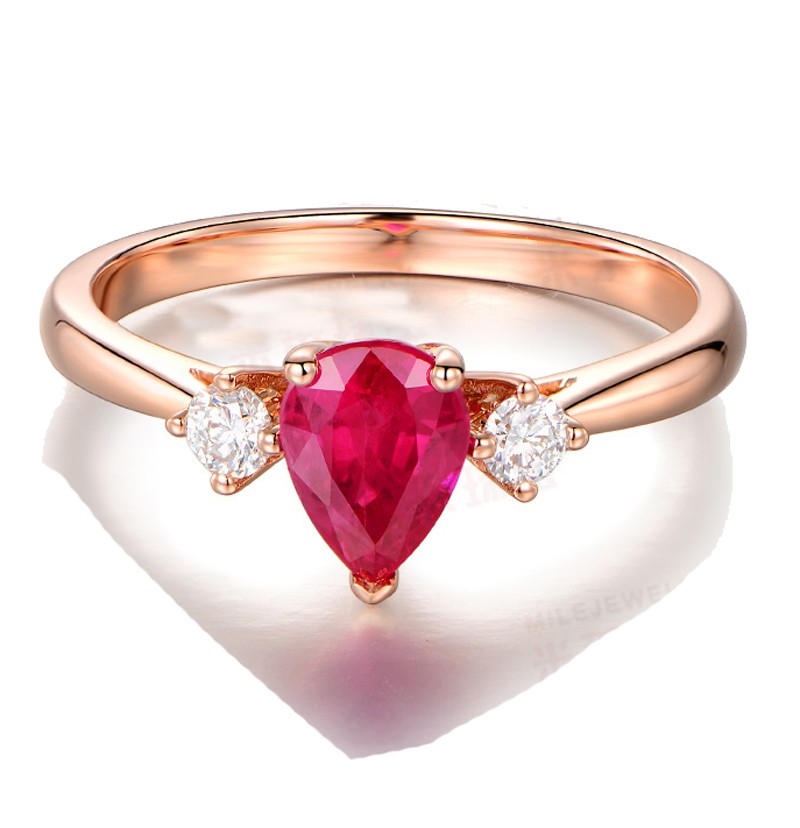 Trilogy Half Carat Pear Shape Ruby and Round Diamond Engagement Ring in Rose