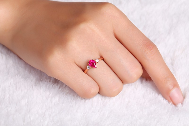 Trilogy Half Carat Pear Shape Ruby And Round Diamond Engagement Ring In Rose Gold