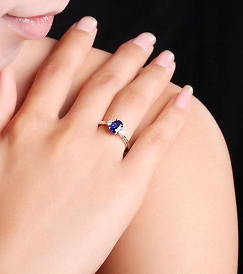 Trilogy Half Carat Oval Cut Sapphire And Round Diamond