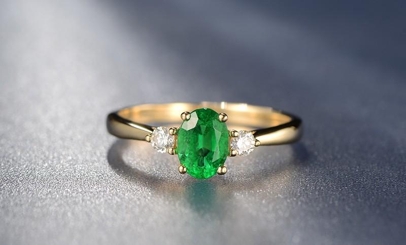 Trilogy Half Carat oval cut Emerald and Round Diamond Engagement