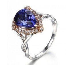 1.50 Carat Pear cut Blue Sapphire and Diamond Antique Designer Engagement Ring in White Gold