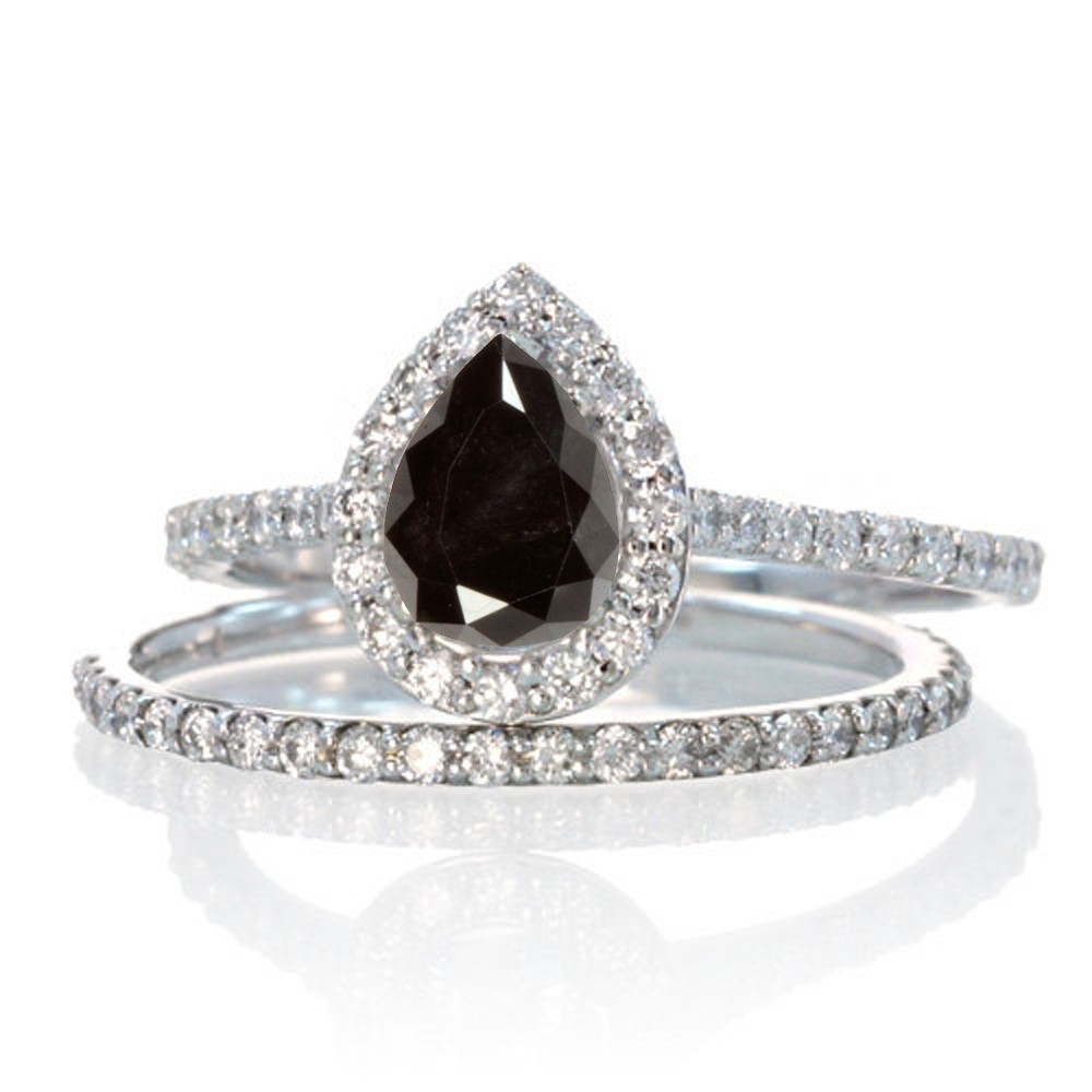 diamond 2 carat pear cut black diamond halo bridal set for woman on