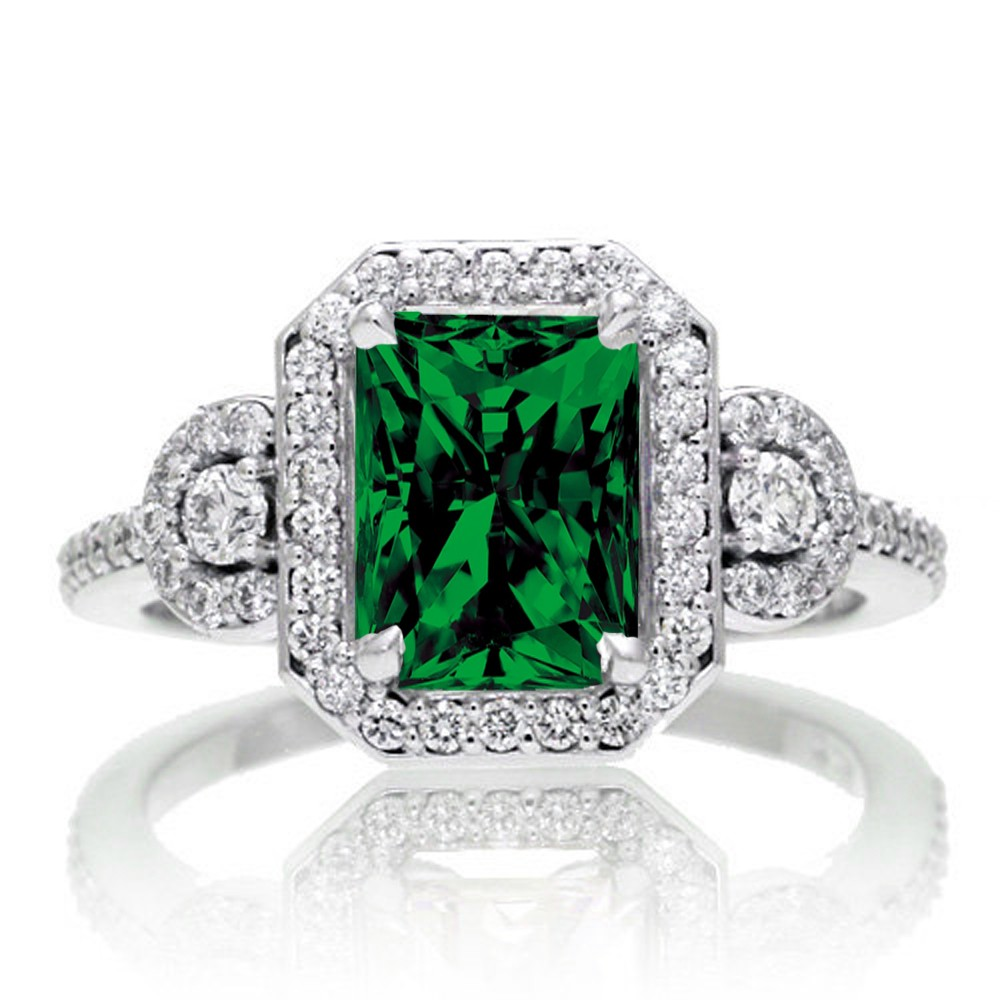 2 carat emerald cut emerald and white diamond halo for Emerald and diamond wedding ring