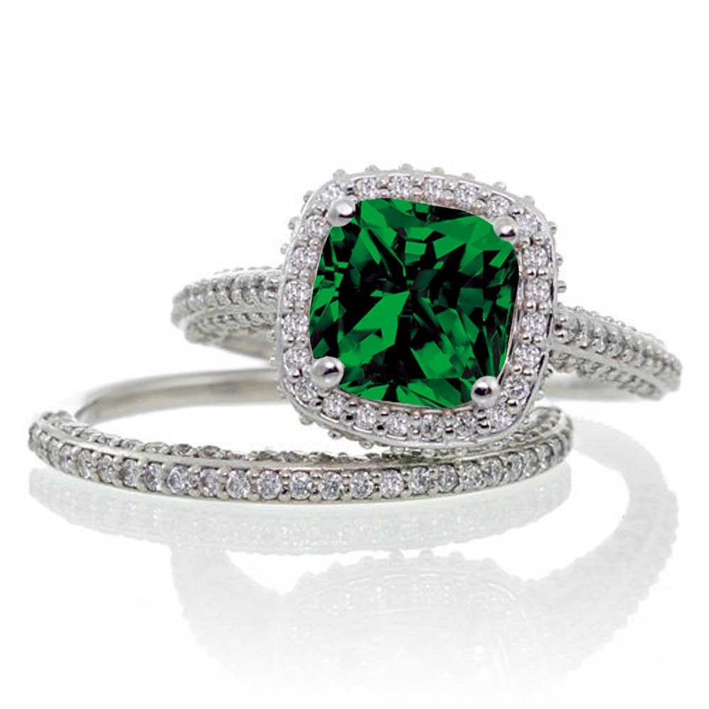 2.5 carat cushion cut designer emerald and diamond halo wedding