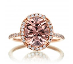 1.5 Carat Oval Classic Emerald and diamond halo ring on 10k Rose Gold