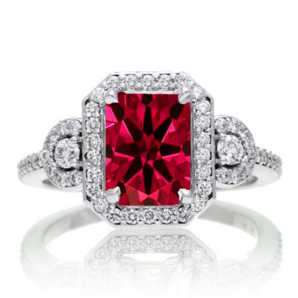2 Carat Emerald Cut Ruby And White Diamond Halo Engagement