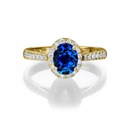 1.50 carat Oval Cut Sapphire and Diamond Halo Engagement Ring in 10k Yellow Gold