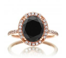 1.5 Carat Oval Classic Black Diamond and diamond halo ring on 10k Rose Gold