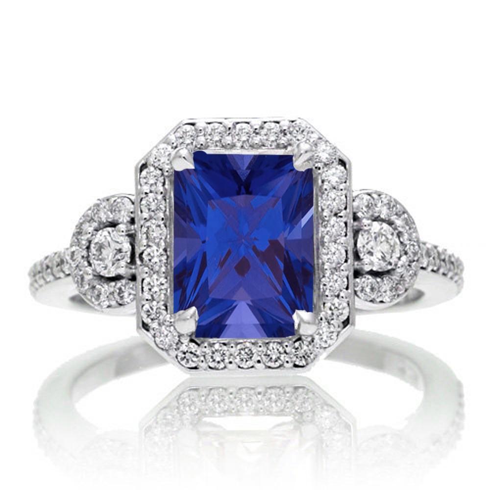 2 carat emerald cut sapphire and white diamond halo. Black Bedroom Furniture Sets. Home Design Ideas