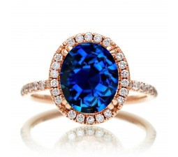 1.5 Carat Oval Classic Sapphire and diamond halo ring on 10k Rose Gold